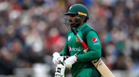Pakistan's Asif Ali walks off after losing his wicket
