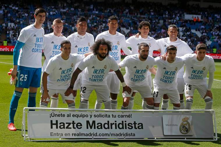 Real Madrid team players pose with shirts supporting former club goalkeeper Iker Casillas before a Spanish La Liga soccer match between Real Madrid and Villarreal at the Santiago Bernabeu stadium in Madrid, Spain