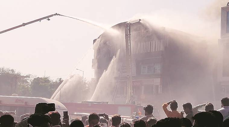 Surat fire, coaching centre fire, Gujarat fire, Vijay Nehra, Ahmedabad Municipal Corporation, Indian Express