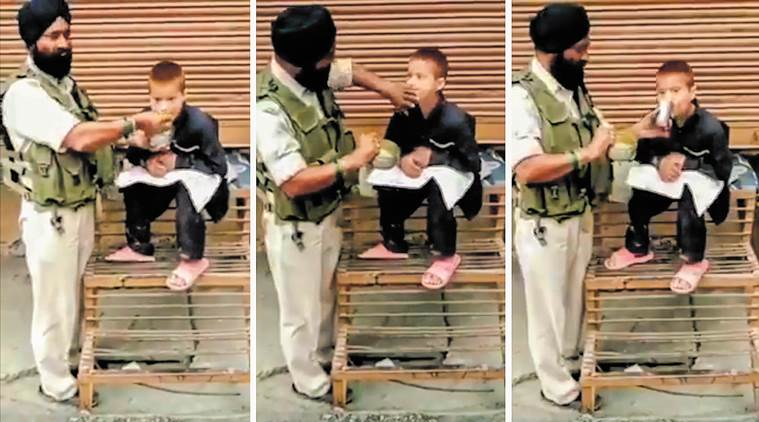 crpf, crpf feeding child, crpf jawan feeding child, jawan feeding child viral video, jammu kashmir, Srinagar, CRPF Srinagar jawan child viral video, indian express, indian express news