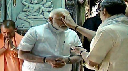 Flanked by BJP president Amit Shah and Adityanath, Modi entered the temple dedicated to Lord Shiva and paid obeisance to the deity as priests recited Sanskrit 'shlokas' in the sanctum sanctorum,