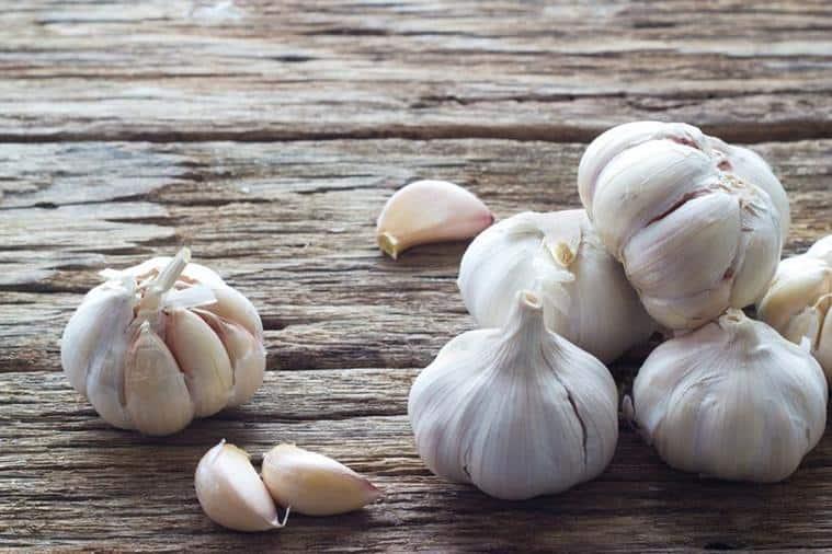 garlic, garlic cloves, world hypertension day 2019, high blood pressure, indian express