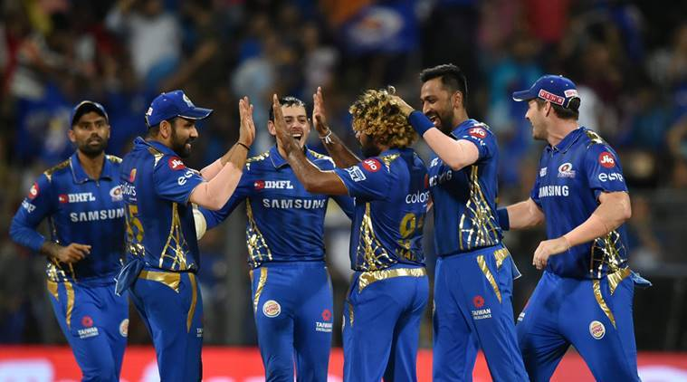 Mumbai Indians (MI) players celebrate the dismissal of Kolkata Knight Riders player Andre Russell during their Indian Premier League 2019 cricket match, at Wankhede Stadium