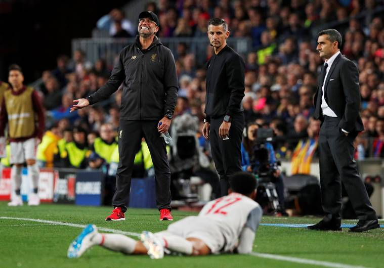 Liverpool manager Juergen Klopp reacts after Joe Gomez goes down and Barcelona coach Ernesto Valverde looks on