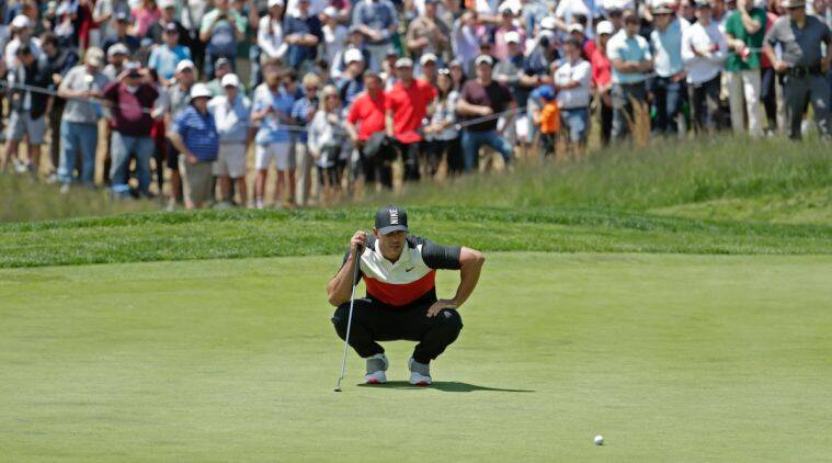 Brooks Koepka lines up a putt on the fifth green during the first round of the PGA Championship golf tournament