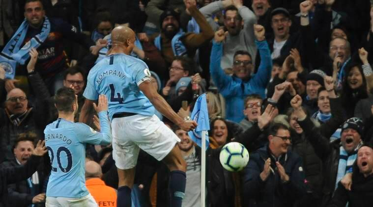 Manchester City's Vincent Kompany, right, celebrates after scoring his side's opening goal during the English Premier League soccer match between Manchester City and Leicester City at the Etihad stadium in Manchester