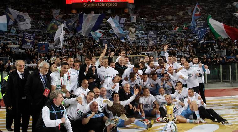Lazio soccer team poses with the Italian Cup trophy at the end of the final match between Lazio and Atalanta, at the Rome Olympic stadium