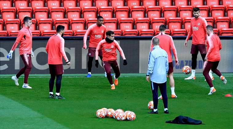 Barcelona's Philippe Coutinho, centre, takes part in a training session, at Anfield Stadium, Liverpool
