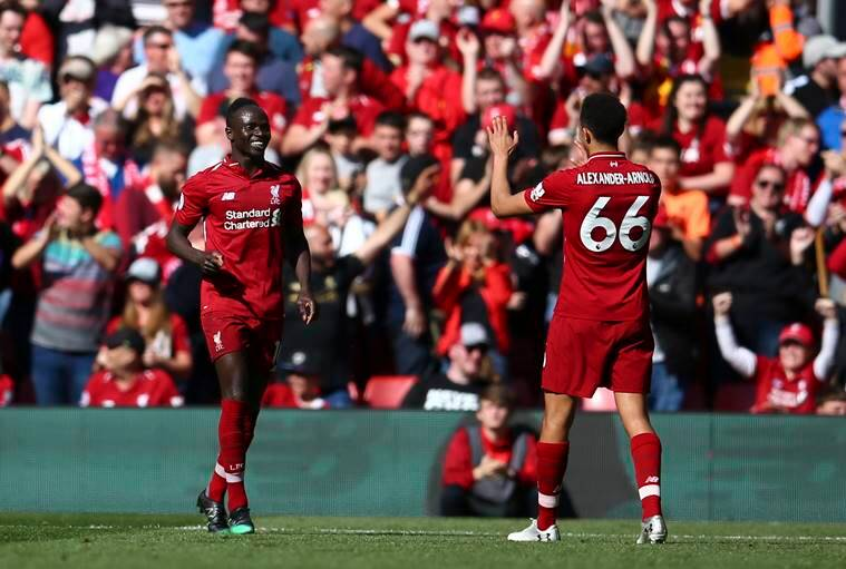 Liverpool's Sadio Mane, left, celebrates with Liverpool's Trent Alexander-Arnold after scoring his side's second goal during the English Premier League soccer match between Liverpool and Wolverhampton Wanderers at the Anfield stadium