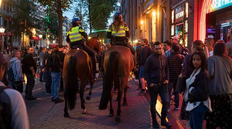 Facing 19 million tourists, the Dutch urge visitors to try somewhere new