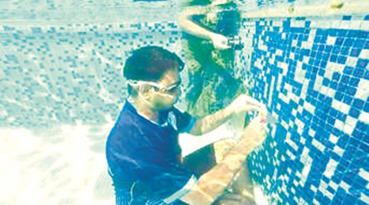 Malad youth solves nine Rubik's cubes underwater, creates Guinness record
