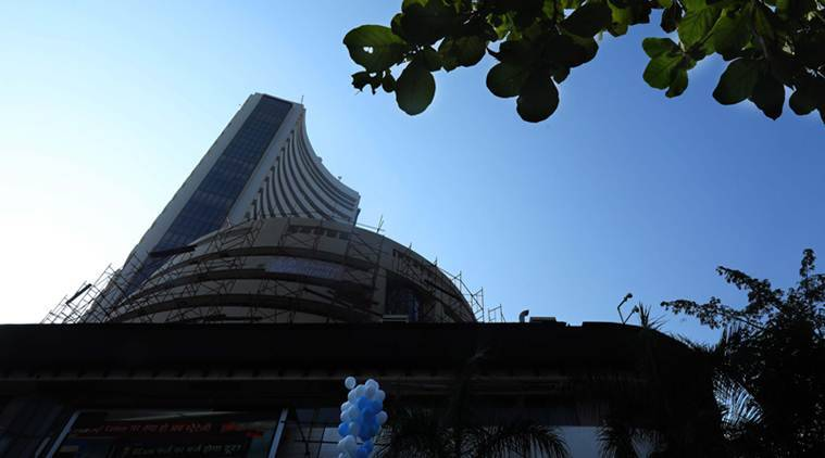 Taking cue from exit polls predicting Modi's return, Sensex surges 1400 points to new high