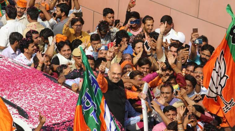 The BJP chief was flanked by a crowd of supporters as the saffron party emerged victorious at many places in the country.