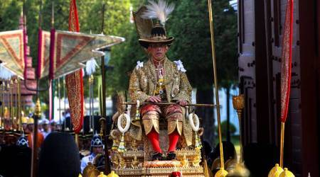 Newly crowned Thai king carried through Bangkok in royal procession