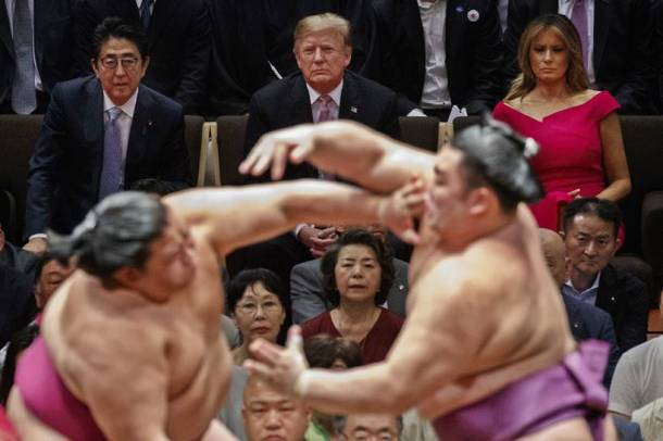 donald trump in japan, trump attends sumo summit photos, trump in japan photos, shinzo abe, japan pm, melania trump, sumo wrestling, world news, indian express