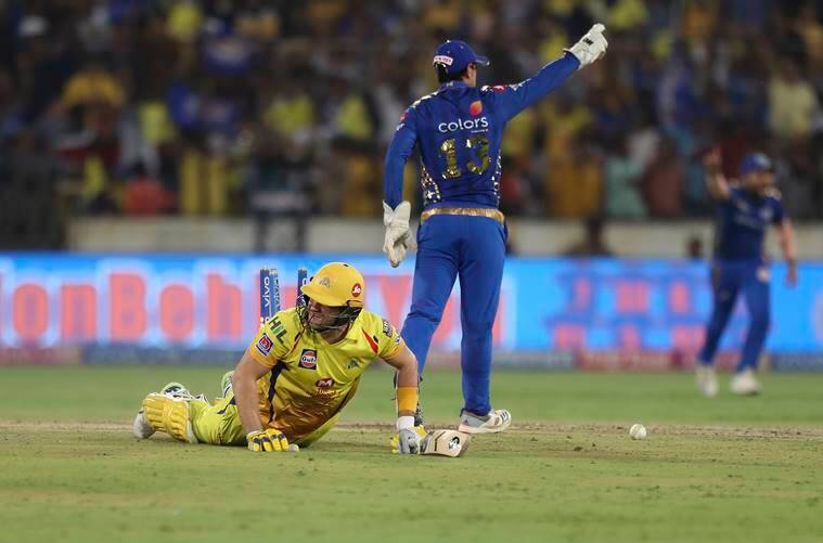 Chennai Super King's Shane Watson, left, falls on the ground after being run-out during the VIVO IPL T20 cricket final match between Mumbai Indians and Chennai Super Kings in Hyderabad