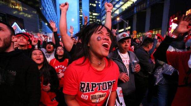 Fans react in the Jurassic Park fan zone during Game 6 of the NBA Finals between the Toronto Raptors and the Golden State Warriors, televised live from Oakland, in Toronto
