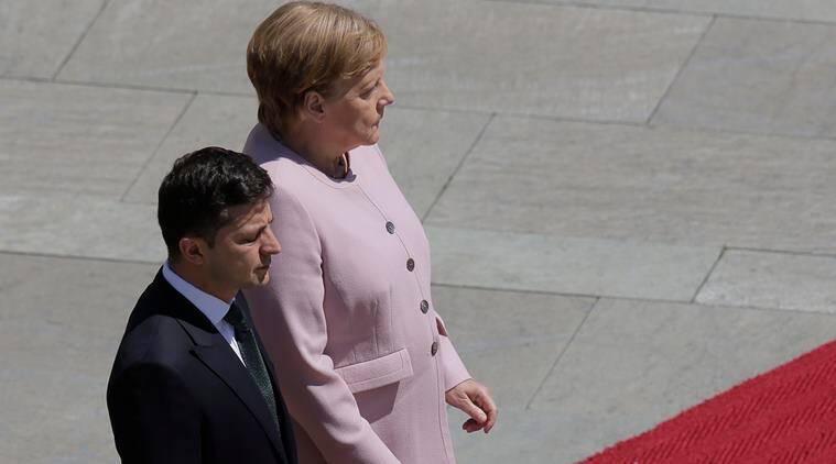angela merkel, angela merkel shaking video, german chancellor trembling in the sun, merkel urkraine president shaking video, germany ukraine meeting, viral videos, indian express