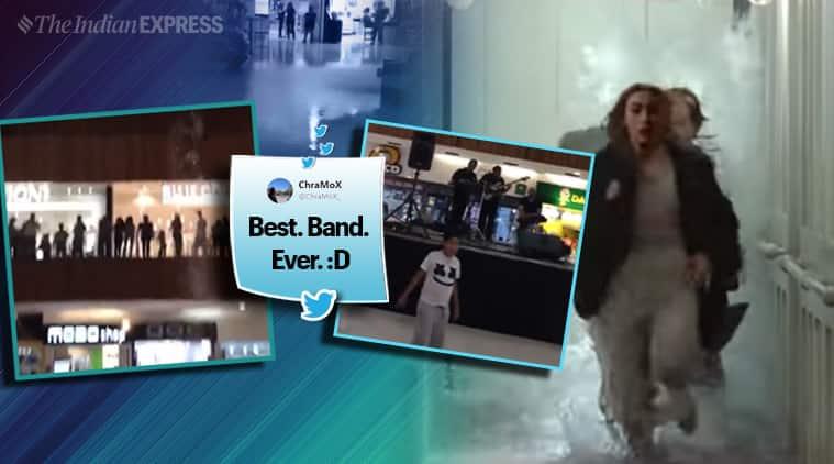 Watch: As heavy rain floods shopping mall, band plays theme