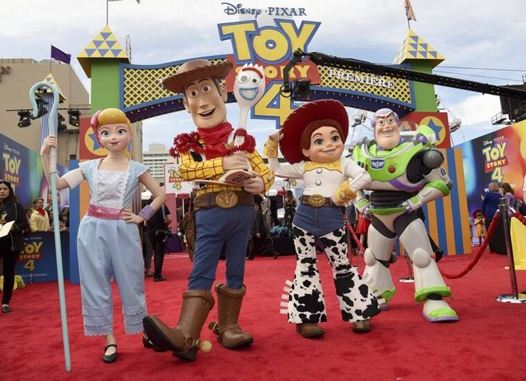 Characters Bo Peep, from left, Woody, Forky, Jessie and Buzz Lightytear pose at the world premiere of Toy Story 4.