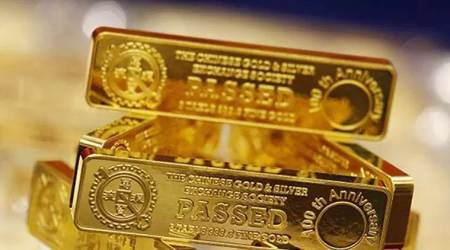 Gold falls 1% as nations plan to ease coronavirus lockdowns, US states with fewer cases ease restrictions, Bank of Japan expands monetary stimulus, Gold set to gain in the long term on safe-haven demand, global gold prices news, commodity market news, business news india, indian express business news