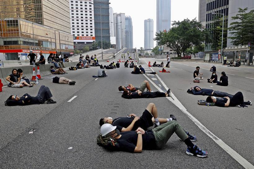 Hong Kong, Hong Kong protest, hong kong protest photos, Hong Kong news, Hong kong protest news, protest Hong Kong, Carrie Lam, Carrie Lam Hong Kong, Hong Kong Carrie Lam, Carrie Lam news, Hong kong black protest, Carrie Lam step down, Carrie Lam resignation, world news, indian express, latest news