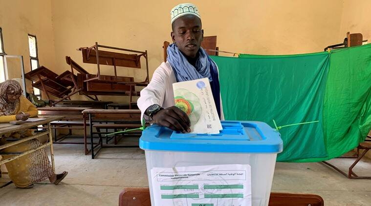 Mauritania votes as first peaceful transfer of power expected country with history of coups