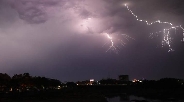 Thunder and lightening accompanied with strong winds wind over Pune. (Express photo by Arul Horizon)