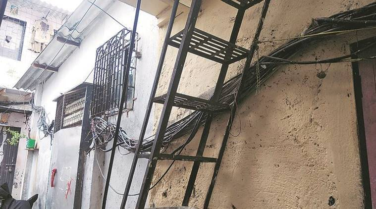 Mumbai: Open wires, illegal metal staircases dot chawl where ... on