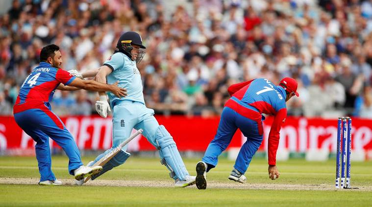 Gulbadin Naib tries to obstruct Eoin Morgan's way to get him run out