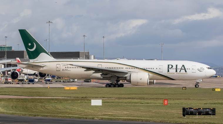 Female passenger mistakes exit door for toilet on PIA flight
