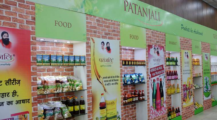 Patanjali financial position, Patanjali acquisition, Patanjali care ratings, Patanjali merger with soya products, indian express news