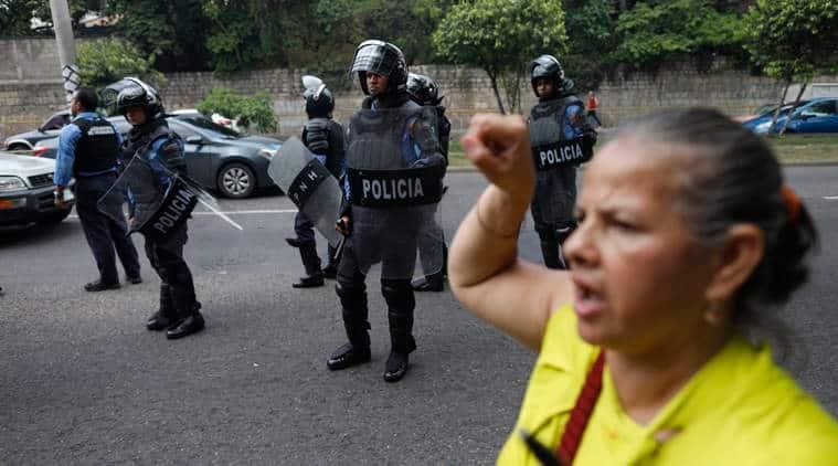 Honduras, Honduras police strike, Honduran police, Riot police, Riot police three-day strike, Riot police work stoppage, Riot police strike, Juan Orlando Hernandez, Juan Orlando Hernandez resignation, anti-Hernandez protesters, World news, Indian Express news