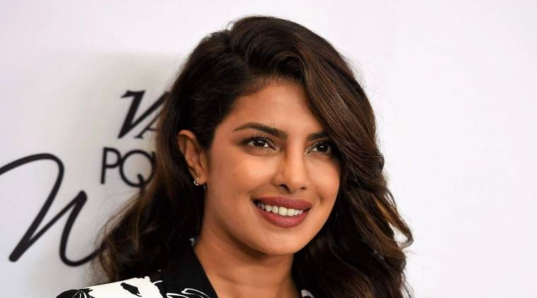 Priyanka chopra, priyanka chopra fashion, priyanka chopra orange, bumble app, jonas brothers, bumble, voluminous hair, bright orange cape dress, fitness trainer Namrata Purohit, Danny Kaye Humanitarian Award, UNICEF Snowflake, indian express, indian express news