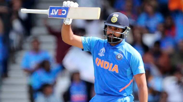 rohit sharma holds up his bat to celebrate scoring fifty runs during the cricket world cup match between india and sri lanka at headingley in leeds
