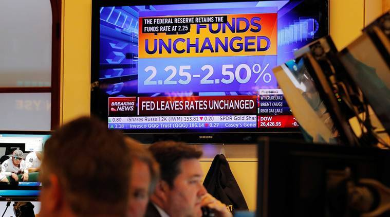 US Fed holds rates steady, signals cuts possible later this year