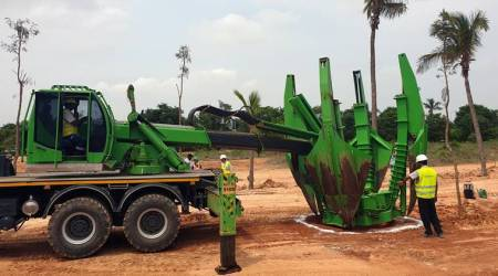 Volvo-Machine-dig-fresh-pit-tree-transplantation-Bengaluru-Bangalore-Airport