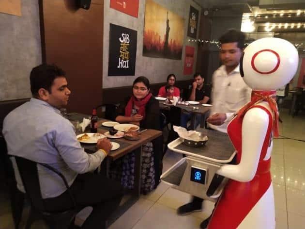 ahmedabad restaurant robots, robots as waiters, ahmedabad restaurant robots as waiters, ahmedabad robot restaurant photos, ahmedabad news, indian express