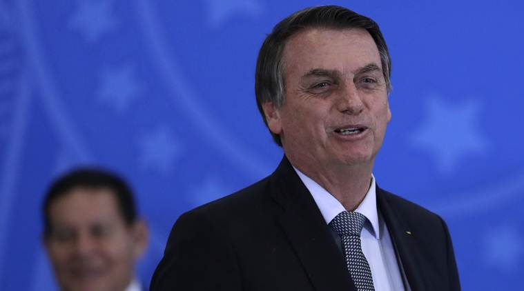 As Amazon burns, Brazil's Bolsonaro tells rest of world not to interfere