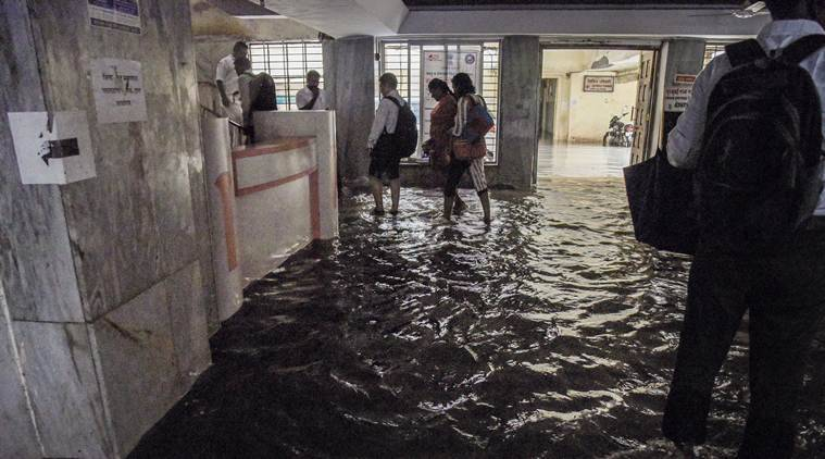 mumbai rains, mumbai rains today, mumbai rains update, mumbai monsoon, heavy rains mumbai, mumbai wall collapse, mumbai trains delayed,