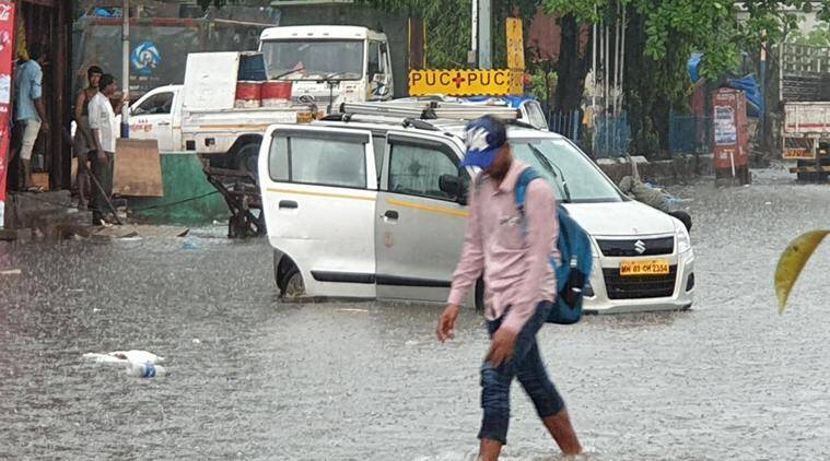 rains in bombay, cancellation of train services due to rains in mumbai,commuters stranded due to rain, high alert in mumbai, city news, indian express