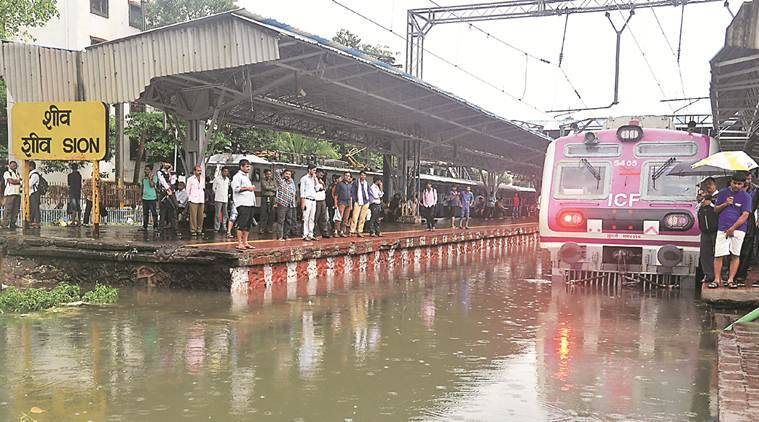 mumbai rains, mumbai monsoons, mumbai floods, mumbai waterlogging, mumbai railways, central railway timetable, mumbai local train time, mumbai news