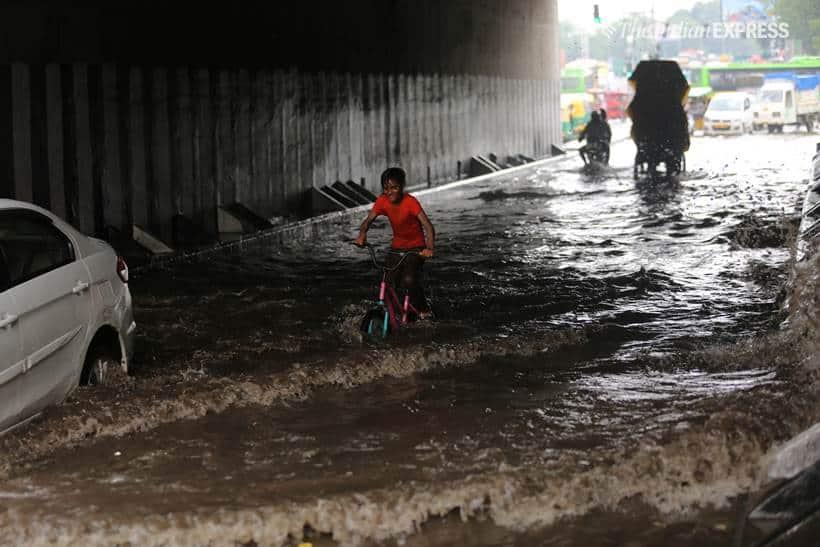 Delhi rains, delhi waterlogged, old delhi rains, raons in old delhi, waterlogged roads in old delhi, delhi weather, fdelhi weather forecast, delhi rain photos, delhi rain pics, delhi rain pictures, old delhi pictures, indian express
