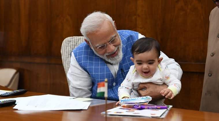 narendra modi, pm modi, narendra modi instagram, modi with kids, modi with child viral photo, Satyanarayan Jatiya, Satyanarayan Jatiya grandkid modi, viral news, indian express