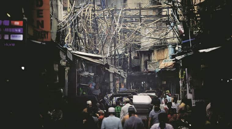 Olde delhi, overhead wires, old delhi hanging wires, old delhi loose wires, electrocution deaths, delhi electrocution deaths, electric wires, electric poles, old delhi overhead wires problem, indian express