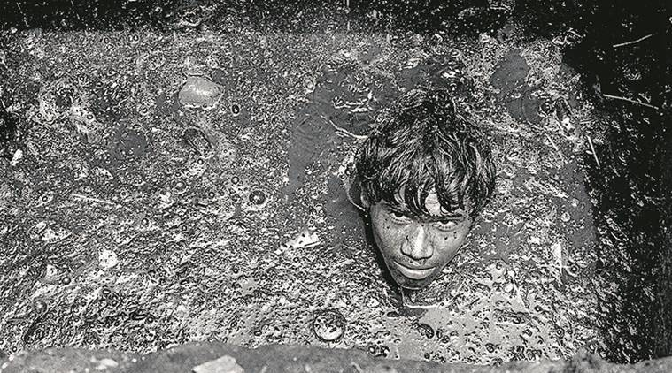 manual scavenging, photo exhibition on manual scavenging, manual scavenging photo exhibition, photo exhibition in Delhi, Sudharak Olwe photo exhibition, Sudharak Olwe manual scavenging photo exhibition, Indian Express news