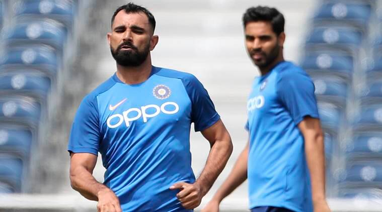 India's Bhuvneshwar Kumar watches Mohammed Shami