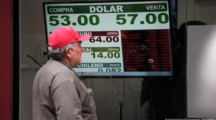 Argentina's peso, stock exchange plunge after President Mauricio Macri vote defeat