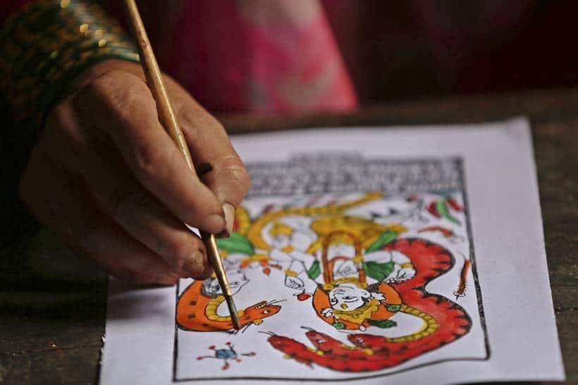 nepal chitrakaar families, nepal art, chitrakar couple, nepal chitrakar art, world news, indian express