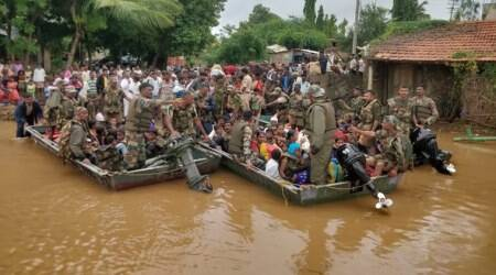 Army personnel rescuing people from the flood-affected areas in Belagavi district.